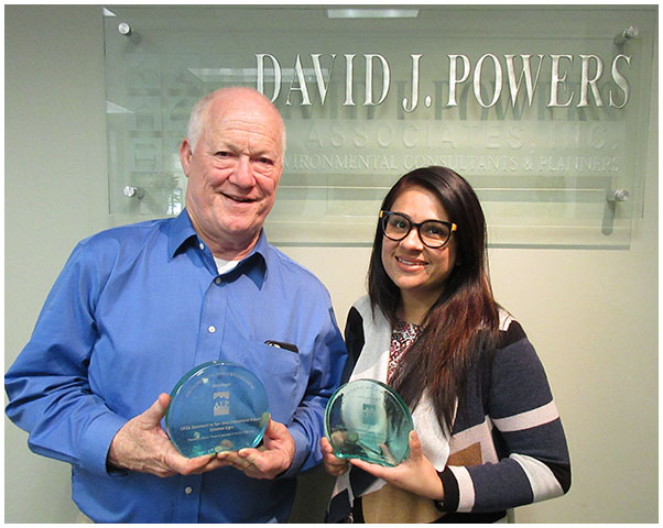 Photo of Pooja Nagrath and John Hesler with their AEP awards for the Silicon Valley Clean Water Wastewater Conveyance System and Treatment Plant Reliability Improvement Project EIR and the Environmental Analysis Merit Award for the Modification to San Jose Municipal Code for Airport Signage Categorical Exemption.